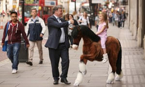 Pocket money for a pony: Shadow Chancellor of the Exchequer Ed Balls walks by the Prancing Pony while on Regents Street.