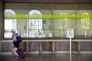 A woman passes by the closed ticketing at Santa Apolonia station during the general strike in Lisbon, on June 27, 2013.
