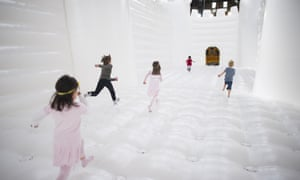 Children run through the 'White Bouncy Castle' installation by artist William Forsythe in Berlin, Germany.