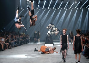 Fall collection? Models wear creations by Rick Owens in Paris as Estonian band Winny Puhh perform live, suspended by their feet.