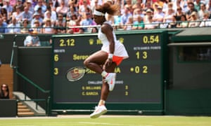 Serena Williams leaps in the air as she celebrates a point.