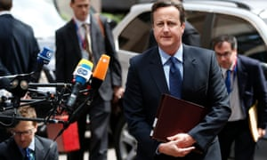 David Cameron arrives at a European Union leaders summit in Brussels today.