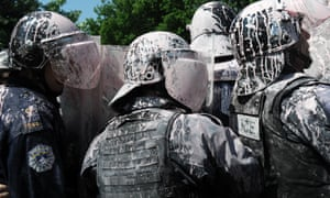 Kosovo Police splashed with paint clash with demonstrators in Pristina during a protest against the ratification of the agreement with Serbia in front of the Assembly and the Government of Kosovo.