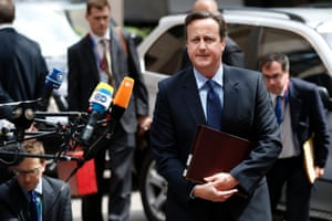 Britain's Prime Minister David Cameron arrives at a European Union leaders summit in Brussels June 27, 2013.