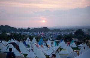 Glastonbury: Sun sets over Glastonbury for the first night of camping
