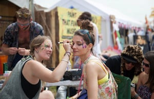 Glastonbury: A festival goer has her face painted