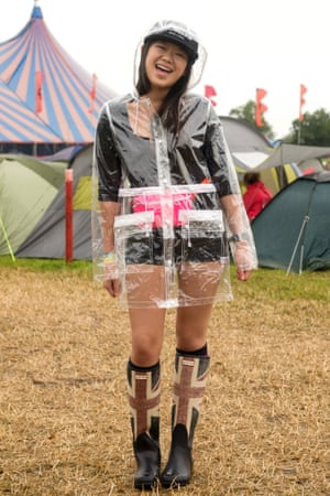 Nicole Ching, 18, of Hong Kong celebrates her first time at Glastonbury with fashion-forward raingear.