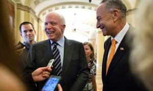 Republican senator John McCain and Democratic senator Chuck Schumer outside the Senate chamber.