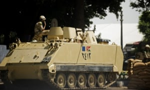 An Egyptian army armoured personnel carrier in the Mahdi neighborhood of  Cairo. Opponents of Egypt's President Mohamed Morsi are pressing ahead with plans to stage mass rallies against the Islamist leader after he marked his turbulent first year in office with a defiant speech.