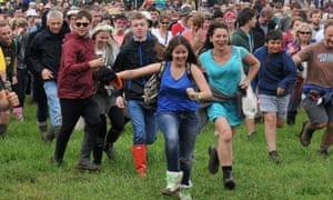Festival goers run to the front to watch Beady Eye perform an unannounced set.