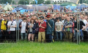 Festival goers wait for the gates to open to see Liam Gallagher.