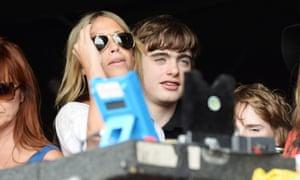 Nicole Appleton and Gene Gallagher watch Beady Eye perform.