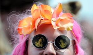 A festival goer waits for singer-songwriter Jake Bugg.