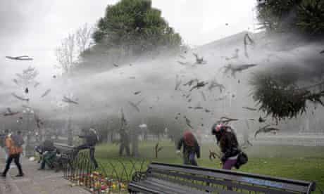 Student protesters in Santiago, Chile, are fired at with water cannon