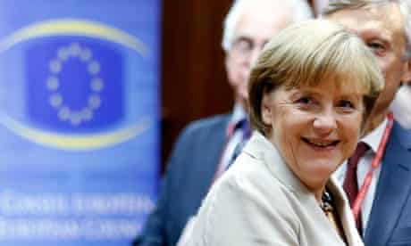 Germany's Chancellor Merkel smiles at the start of a European Union leaders summit in Brussels