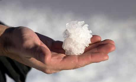 A clump of salt crystals in a man's hand