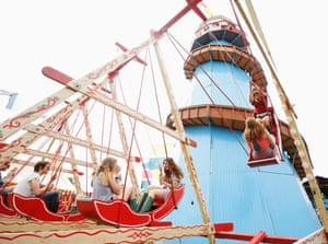 Festival goers enjoy old fashioned fair rides in the Spirit of '71 field.