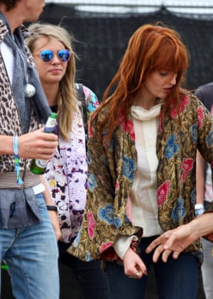 Florence Welch is pictured here, with supermodel Cara Delevingne sneaking into the background.