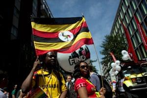 London Pride: Participants hold a Ugandan flag