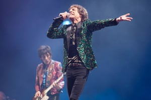 Rolling Stones: Mick Jagger and Ronnie Wood in the background