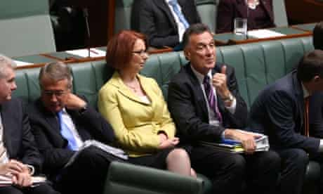 Prime Minister Julia Gillard talks with Minister for Trade Craig Emerson during a division of the House. The Global Mail. Mike Bowers.