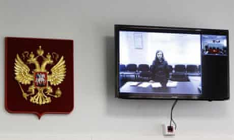Pussy Riot Maria Alyokhina on a monitor inside the courtroom during a hearing in Berezniki