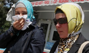 Two women affected by teargas walk in the city centre in Ankara, Turkey, on Monday, June 3, 2013. Turkish Prime Minister Recep Tayyip Erdogan on Monday again dismissed street protests against his rule as actions organised by extremists.