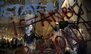 Graffiti covers a shop window on Taksim in Istanbul, Turkey