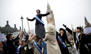 Feminist activists dressed suffragettes