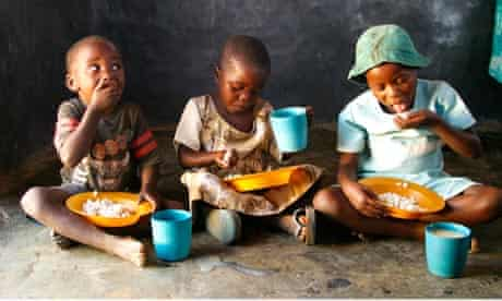Children with food aid meal at community centre