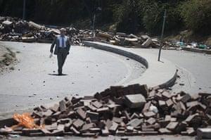 Turkey protests: A man walks past makeshift barricades