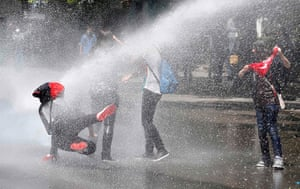 Turkey protests: Police use water cannon against protesters during a demonstration in Ankara