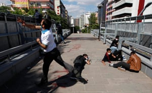 Turkey protests: Protesters take cover during clashes with riot police