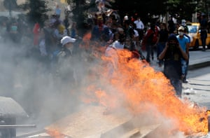 Turkey protests: Protesters gather behind a barricade in Ankara