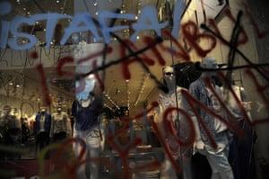 Turkey protests: Graffiti covers a shop window in Taksim Square, Istanbul