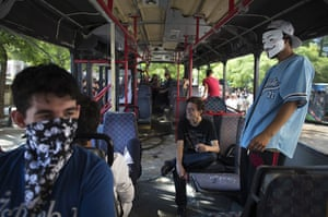 Turkey protests: Protestors sit in a damaged bus in Taksim Square in Istanbul