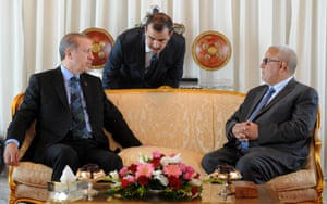 Turkish Prime Minister Recep Tayyip Erdogan (L) talks to an interpreter as he sits alongside Moroccan Prime Minister Abdelilah Benkirane (R) at Rabat airport on June 3, 2013 at the start of a tour of the Maghreb region as unprecedented anti-government protests swept Turkey. Erdogan is expected to leave Morocco for Algeria on Tuesday morning before traveling to Tunisia, where he will take part in the first meeting of the Turko-Tunisian strategic cooperation council, according to his office.