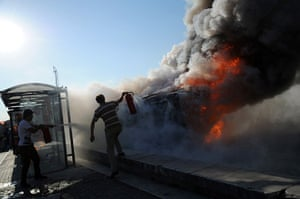 Turkey protests: A Police car set alight in Taksim square, Istanbul