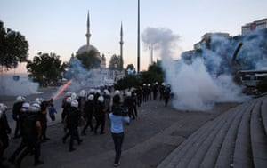 Riot police use tear gas to disperse the crowd during an anti-government protest in Istanbul June 3, 2013.