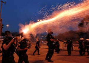 Turkish riot police fire tear gas to disperse protestors near Taksim Square in Istanbul. More than 2,300 people have been injured and one person killed during four days of fierce clashes between protesters and police in Turkey, according to a doctors' association, as the prime minister blamed 'extremist elements' for the riots.