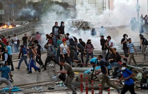 Protestors run away from Turkish riot police (out of frame) using tear gas near Taksim Square in Istanbul, Turkey, 03 June 2013.