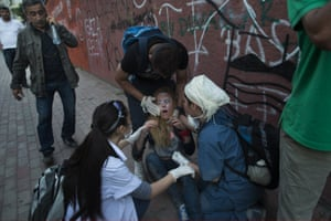 A protestors is treated after she was hit by tear gas during clashes with Turkish police near Turkish Prime Minister Recep Tayyip Erdogan's office, between Taksim and Besiktas on June 3, 2013 in Istanbul, Turkey.