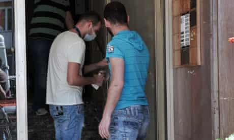 Police officers take fingerprints in Athens