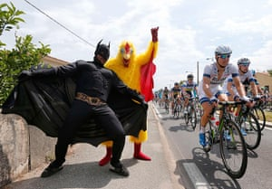 TDF: Fans dressed in costumes cheer on the pack of riders