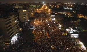 Protesters opposing Egypt's President Morsi gathering in front of El-Thadiya presidential palace in Cairo.
