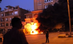 Egyptians opposing President Morsi start a fire at Muslim Brotherhood offices in Cairo.