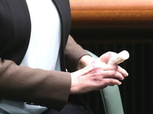 The Prime Minister Julia Gillard holds a tube of throat lozenges during Question Time.