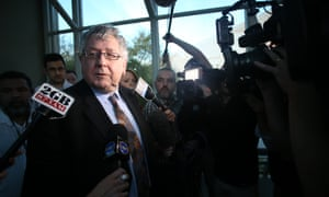 The Member for Werriwa Laurie Ferguson negotiates the media pack in the press gallery of Parliament House.