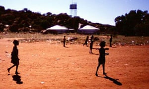 Indigenous children playing in a community near Alice Springs
