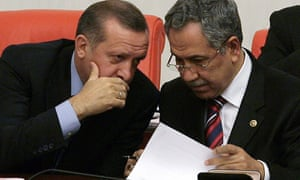 File images showing Turkish Prime Minister Recep Tayyip Erdogan talking to his deputy Bulent Arinc during a debate at the parliament in Ankara.